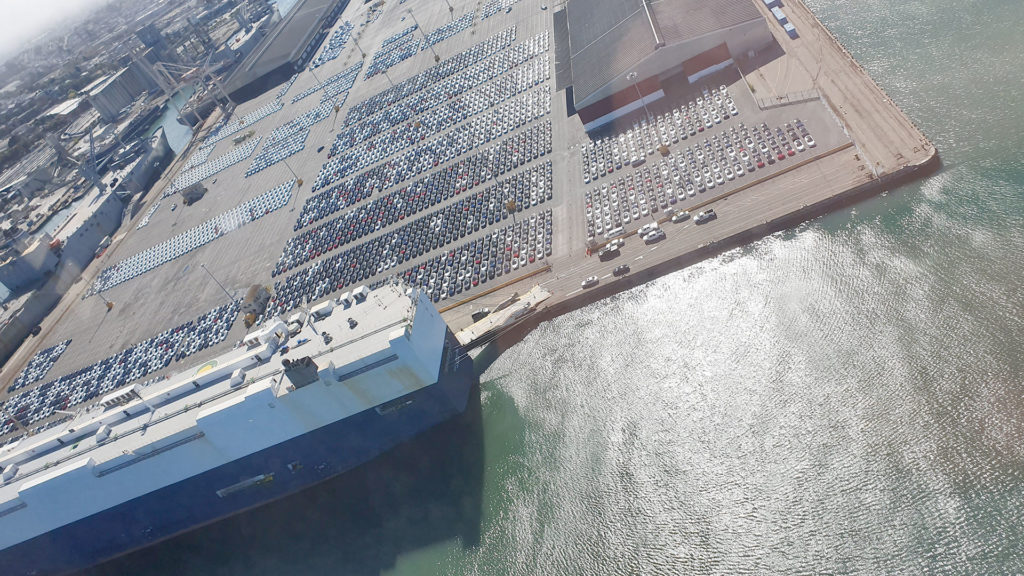 Aerial view of the Port of San Francisco Pier 80 showing thousands of Tesla Model 3s ready to be shipped.