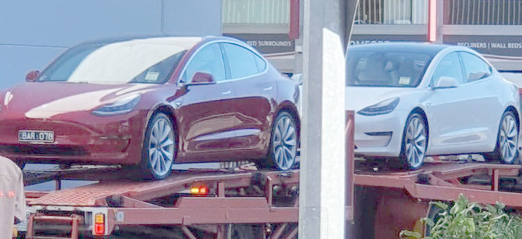 Tesla Model 3 electric vehicles arrive in Brisbane, soon to be followed by a ship loaded with cars for customers.