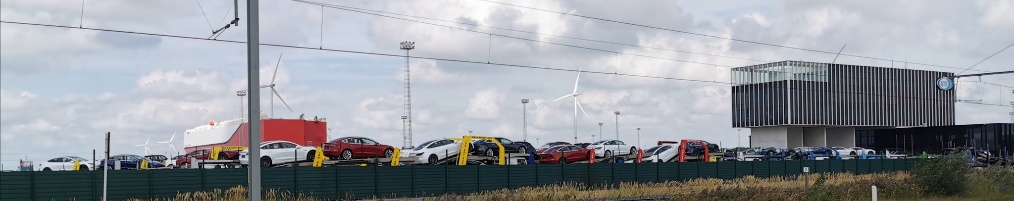 Tesla Model 3 electric cars being loaded into car carrier trucks at the Port of Zeebrugge, Belgium.