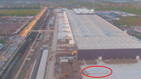 Gigafactory 3's latest footage shows a 20 stall Supercharger station.