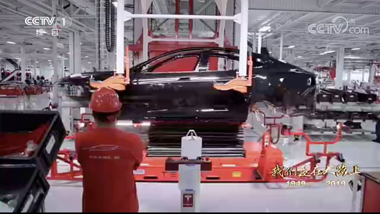 Tesla Model 3 assembly line being tested at the Gigafactory 3, Shanghai. Side view.