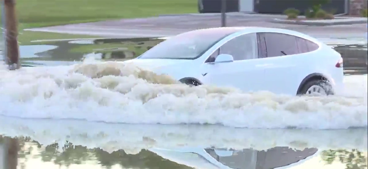 Tesla Model X driving through the flood.