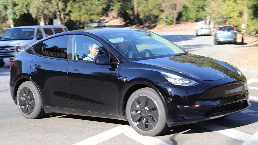 Black Tesla Model Y - front side view