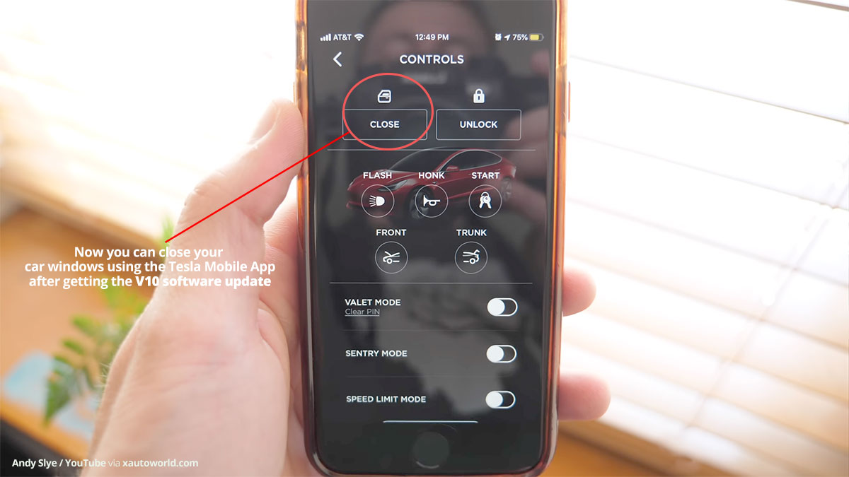 Using the 'Close Windows' function from the Tesla mobile app.