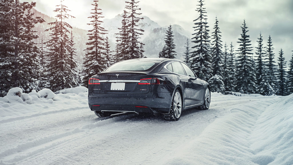 Tesla Model S in the snowy wilderness.