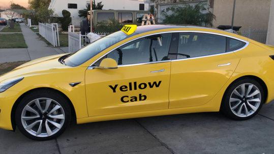Tesla Model 3 as yello cab/taxi.