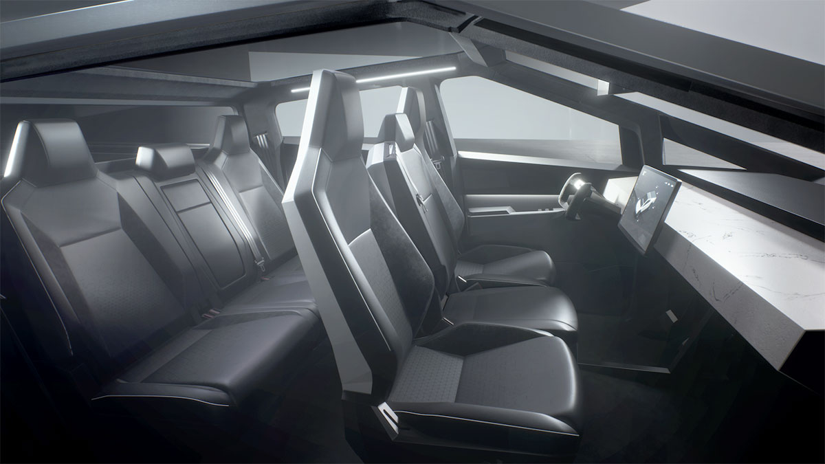 Interior view of the Tesla Cybertruck's seats and the bland and square dashboard.