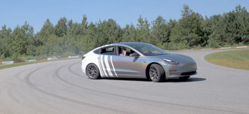Tesla Model 3 drifting on the race track.
