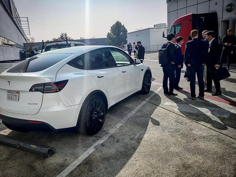 Tesla Model Y Performance prototype at the Tesla Fremont factory with black wind turbine wheels.