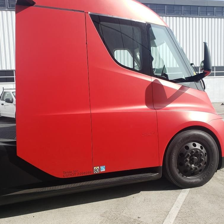 Red Tesla Semi Truck prototype at the Fremont factory, side view.