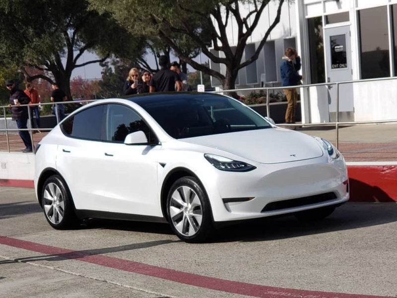 White Tesla Model Y with the Chinese style high performance aero wheels.