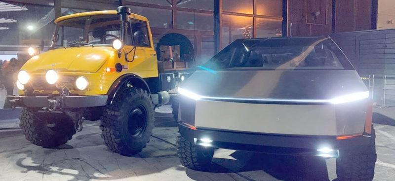 Tesla Cybertruck standing besides a Mercedes Benz Unimog Truck.