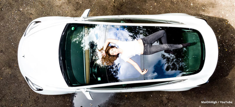 MaiOnHigh on top of her Model 3.