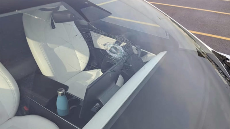 Condition of the Tesla Model 3 windshield after getting hit by the hammer.