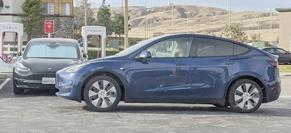 Tesla Model Y spotted at a Supercharger, Model 3 seen charging in the background.