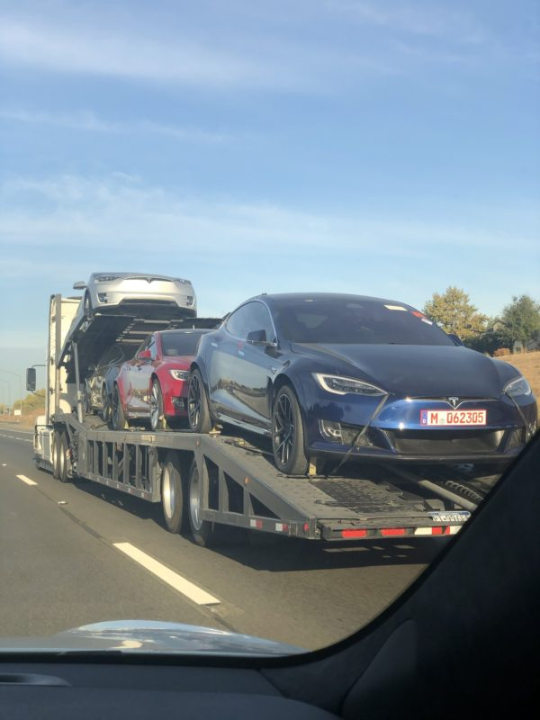 Tesla Model S Plaid prototypes returning home on a car carrier trailer.