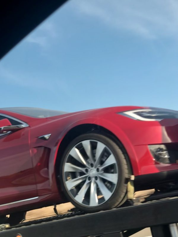 Tesla Model S Plaid prototypes returning home, close look at the silver wind turbine wheel of the red car.