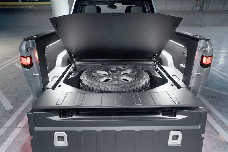 Rivian R1T rear bin under the truck's bed for spare wheel storage.