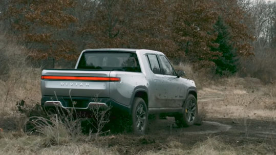 Rivian R1T Pickup Truck doing a 'tank turn' demonstration.