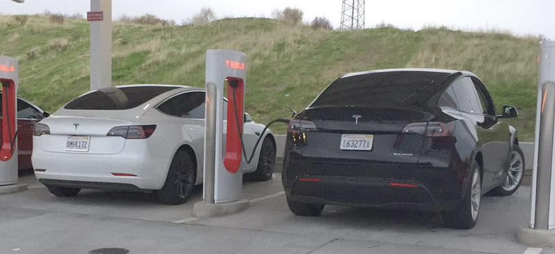 Tesla Model Y and Model 3 charging side-by-side at the Kettleman City Supercharger.