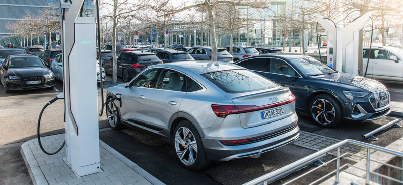 Audi electric cars charging at a proprietary charging station in Germany , automaker plans to invest €100M in charging infrastructure.