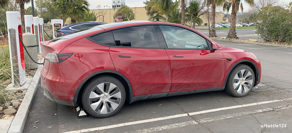 Red Tesla Model Y prototype at a California Superchargers station.
