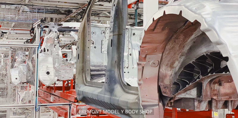 Model Y compact electric SUV body shop at the Tesla Fremont car factory.