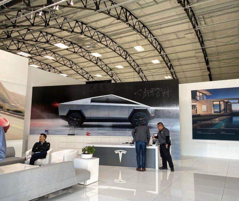Tesla Design Center reception now has the Cybertruck picture.