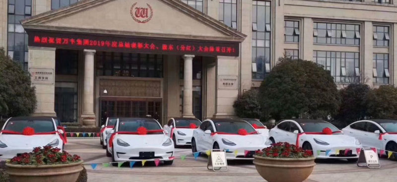 Tesla Model 3 cars as 'employee of the year' awarded by some companies in China.
