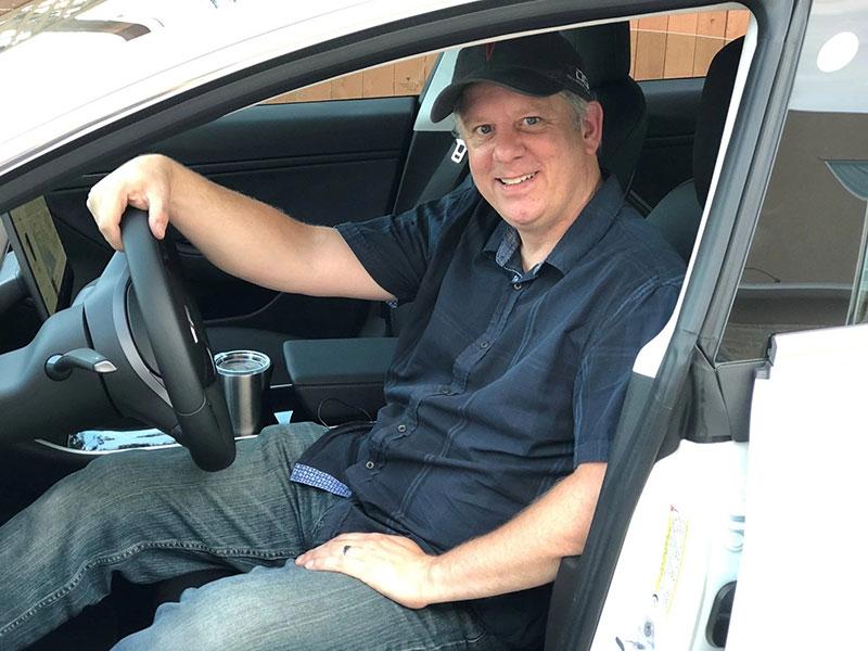 Trevor Page inside his Tesla Model 3