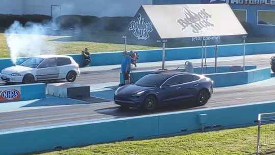 Tesla Model 3 Dual-Motor AWD vs. Civic Hatchback drag race. The Civic literally has a chimney on the hood.
