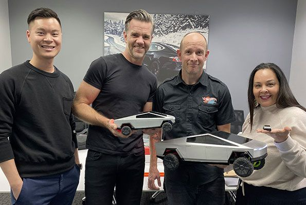 Tesla Chief Designer Franz von Holzhausen with Mattel's RC Cybertruck design team.
