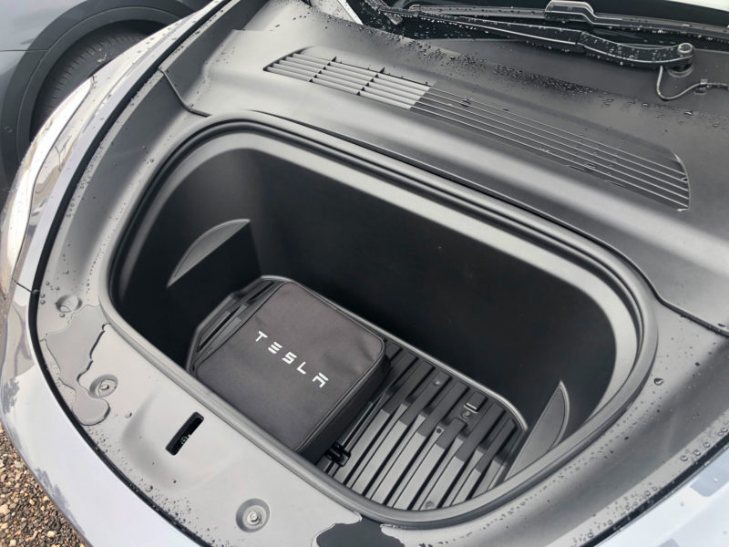 Tesla Model Y's wider and deeper frunk (front trunk) closeup photo.