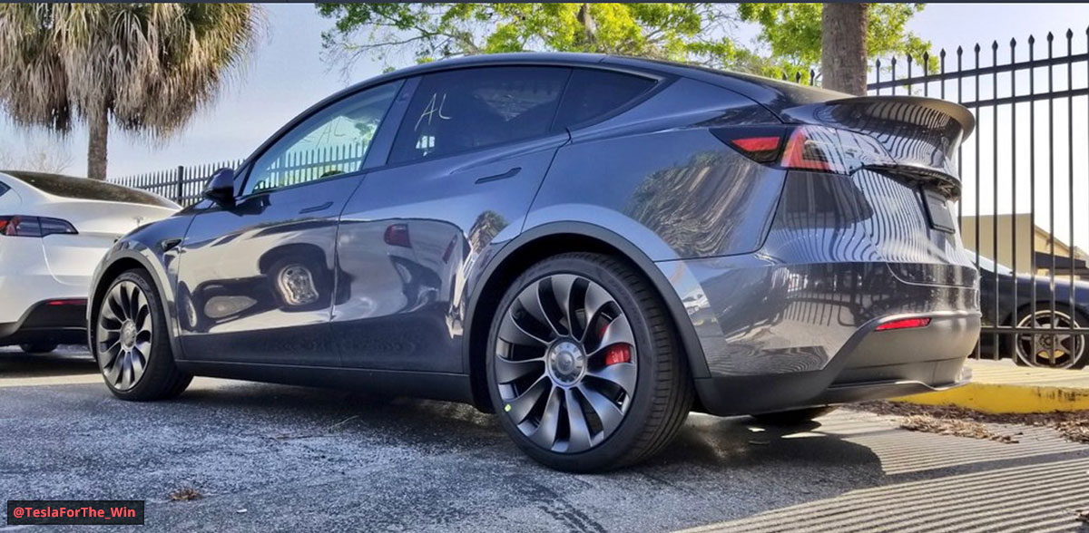 Tesla Model Y SUV in Midnight Silver Metallic (gray) color at the Tesla HQ delivery center.