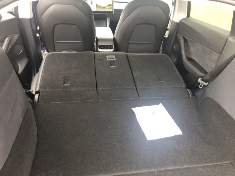 Tesla Model Y trunk with seats down flatbed.