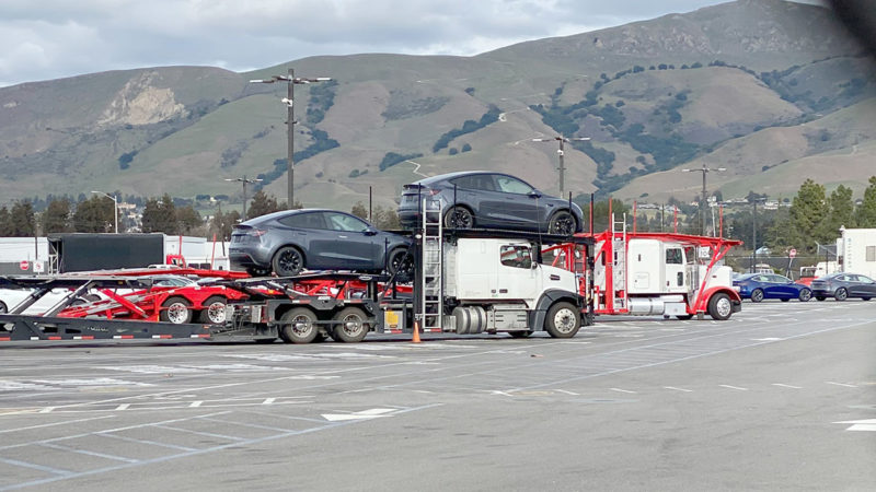 Tesla Model Y electric SUVs loaded on car carrier trailers to start deliveries to the Tesla delivery centers/stores.