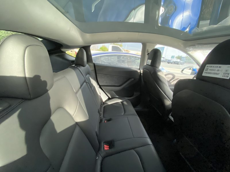 Tesla Model Y Interior - full glass roof, view from the inside.