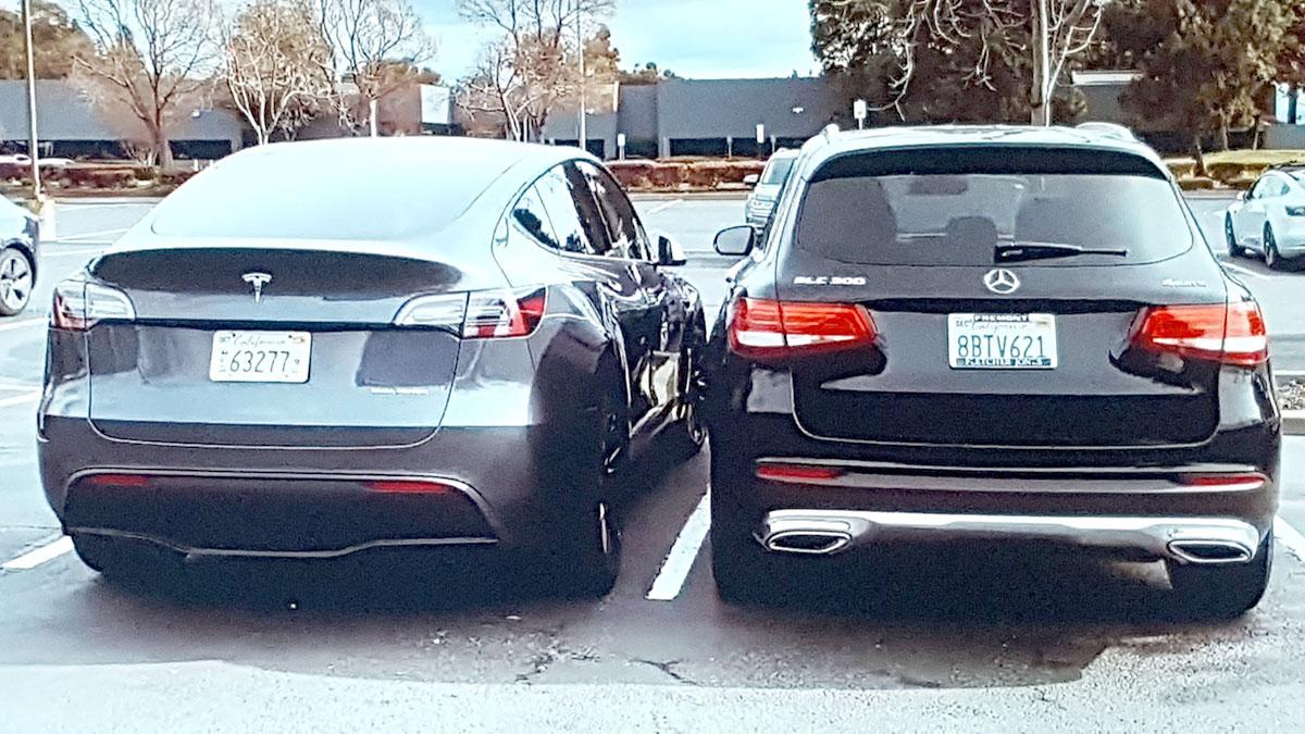Tesla Model Y side-by-side Mercedes GLC 300 at Tesla Fremont, California.
