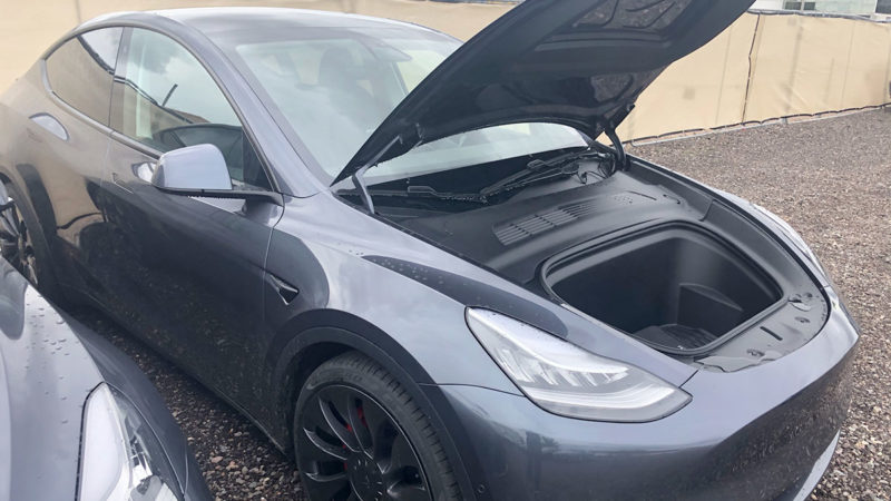 Tesla Model Y front trunk lid open (closeup picture below).