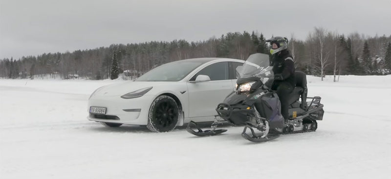 Tesla Model 3 vs. Snowmobile drag race.