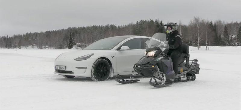 Tesla Model 3 vs. Snowmobile drag race.