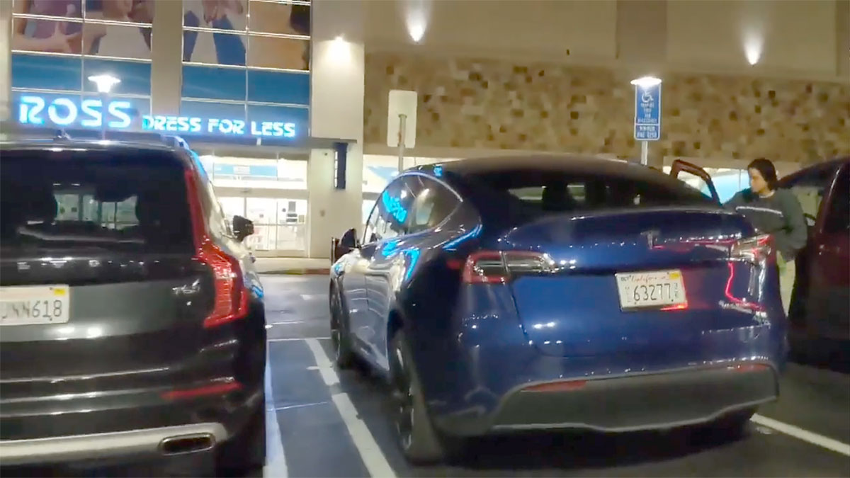 Tesla Model Y parked side-by-side with a Volvo XC90 mid-sized luxury SUV.