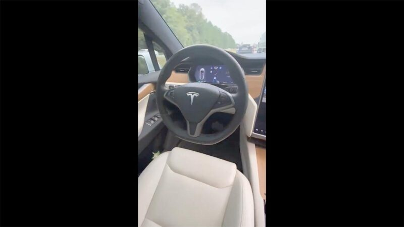 Tesla Model S on Autopilot without the driver.
