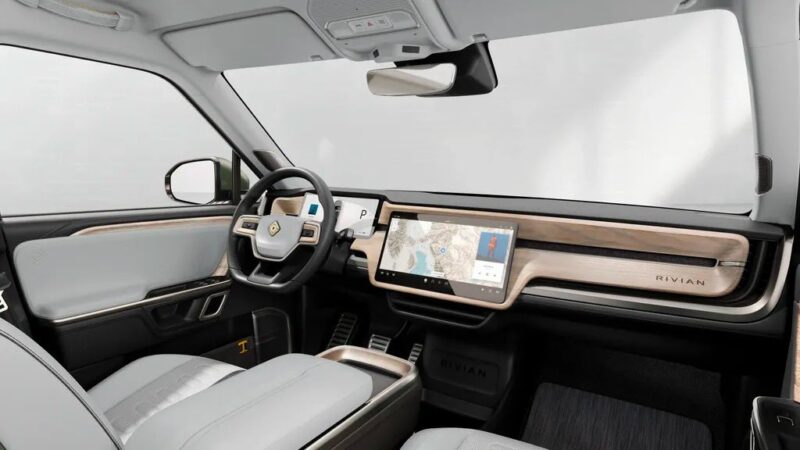 Rivian R1T interior dashboard, steering wheel, and center touchscreen in Ocean Coast finish.